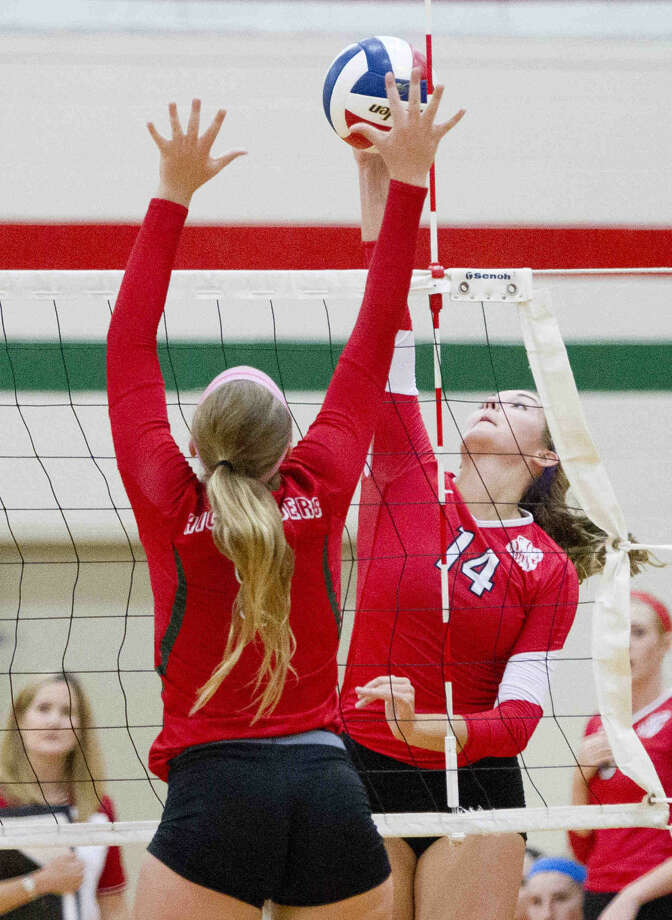 Katy's Stephanie James goes up against The Woodlands' Courtney Heiser during a high school volleyball game Tuesday. The Woodlands rallied from two sets down to defeat Katy in five sets. Photo: Jason Fochtman