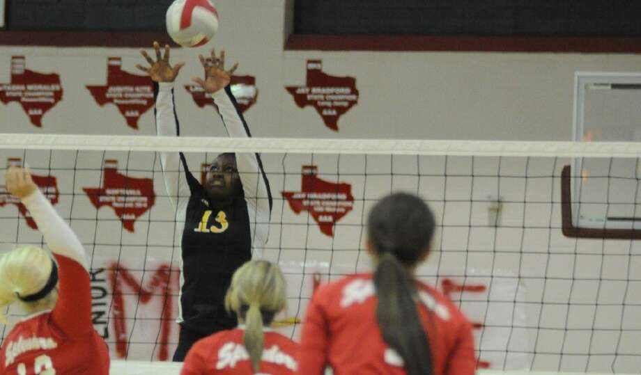 Liberty's Denise Booker tries for a block against Splendora in a District 23-4A match on Tuesday at Splendora High School, Sept. 30. Photo: Keith MacPherson