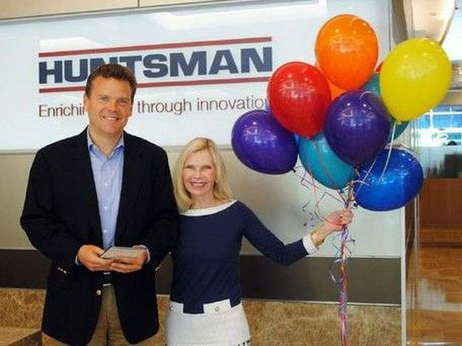 The Huntsman Corporation has been named a 2014 Hometown Hero. Pictured are Peter Huntsman (left), President and Chief Executive Officer, Huntsman Corporation and Dr. Ann Snyder (right), President and CEO of Interfaith of The Woodlands.