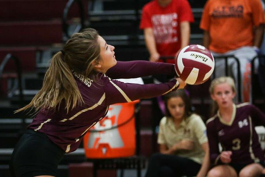 Magnolia West's McKenna Meyers (17) returns a serve during the high school volleyball game against Conroe on Tuesday, Sept. 8, 2015, at Magnolia West High School. To view more photos from the game, go to HCNPics.com.