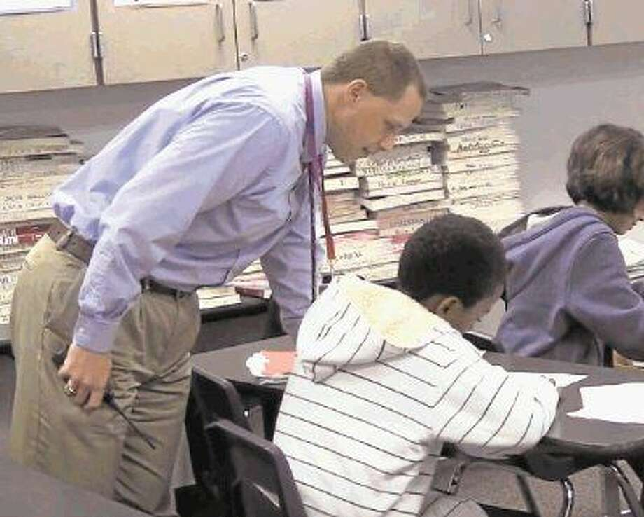 Ulrich principal Jeff Bailey works with students in the classroom. Photo: Klein ISD
