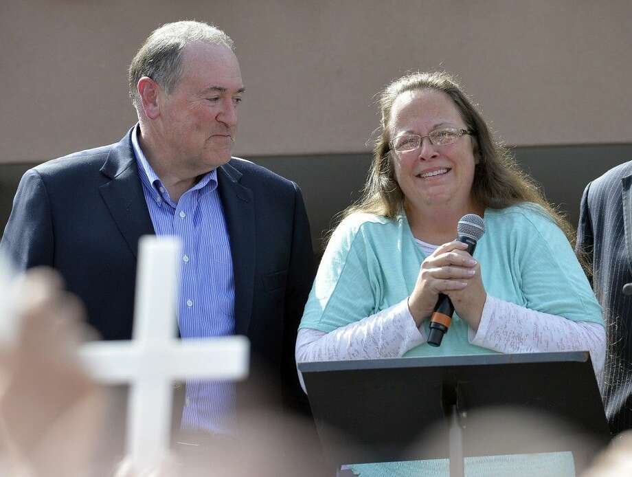 Rowan County Clerk Kim Davis, with Republican presidential candidate Mike Huckabee, left, at her side, speaks after being released from the Carter County Detention Center, Tuesday in Grayson, Ky.
