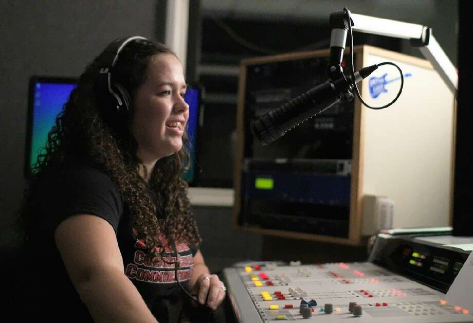 ACC File photo of student working the controls at KACC 89.7 FM.
