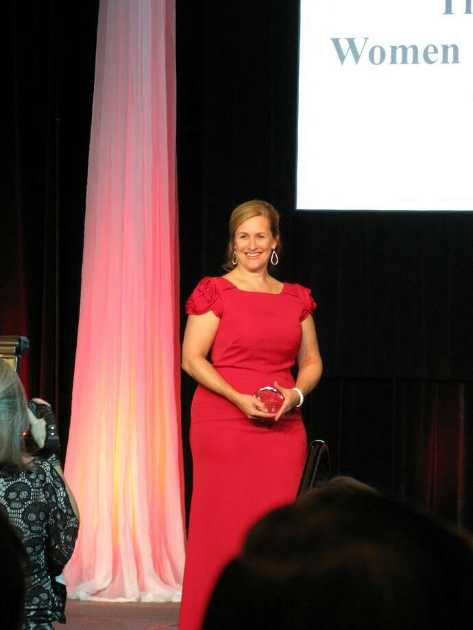 Carol Fellbaum, owner of A Dog's Life Pet Salon & Boutique in Spring, was honored chosen by the Federation of Houston's Professional Women's as the 2014 Woman of Excellence. She was honored during their annual gala in downtown Houston at the Hyatt Regency on Sept. 27.