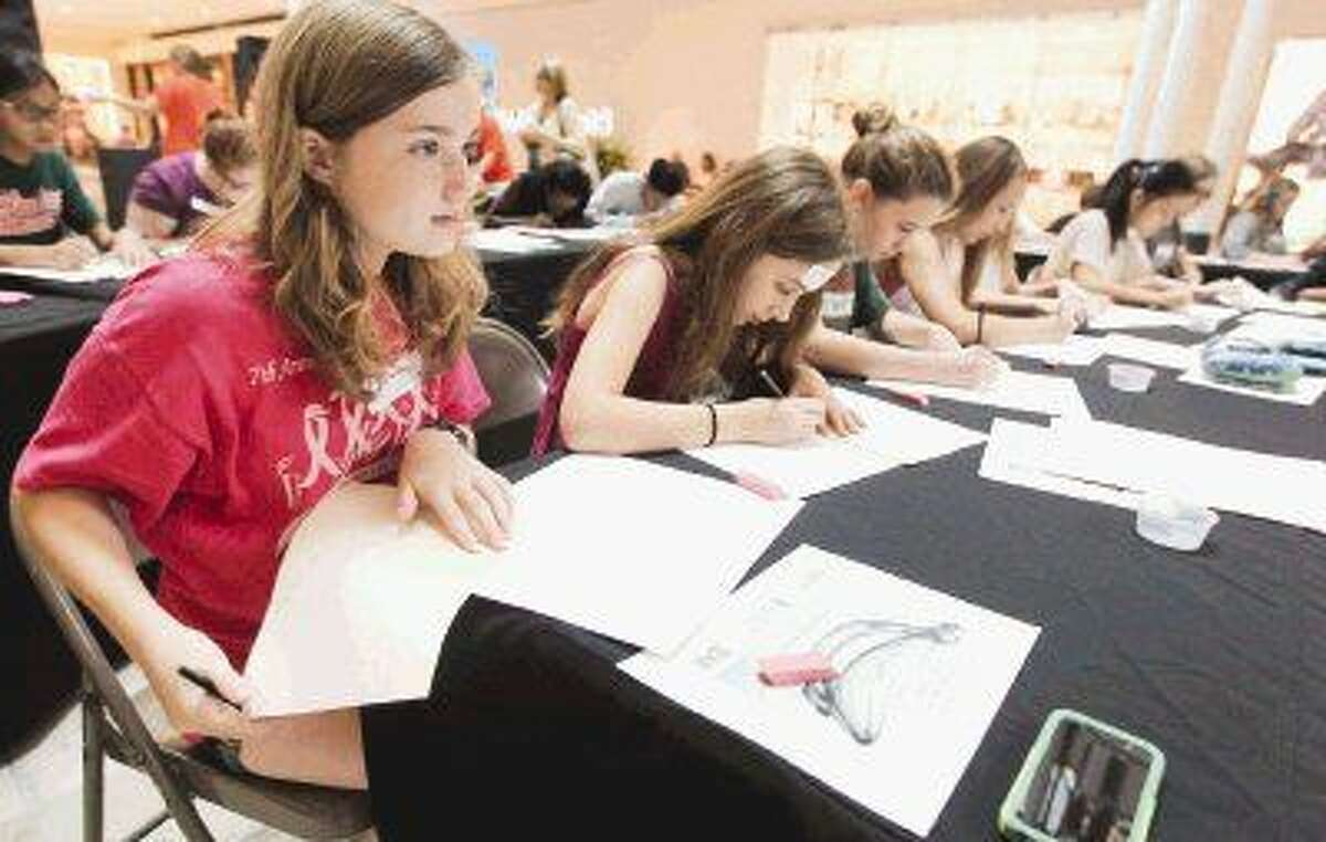 Ellie Timmins works on a still-life sketch during the Because Art Matters fast-draw competition at The Woodlands Mall Saturday. Seventh- and eighth-grade students were given 50 minutes to complete a still-life drawing for various Microsoft prizes.