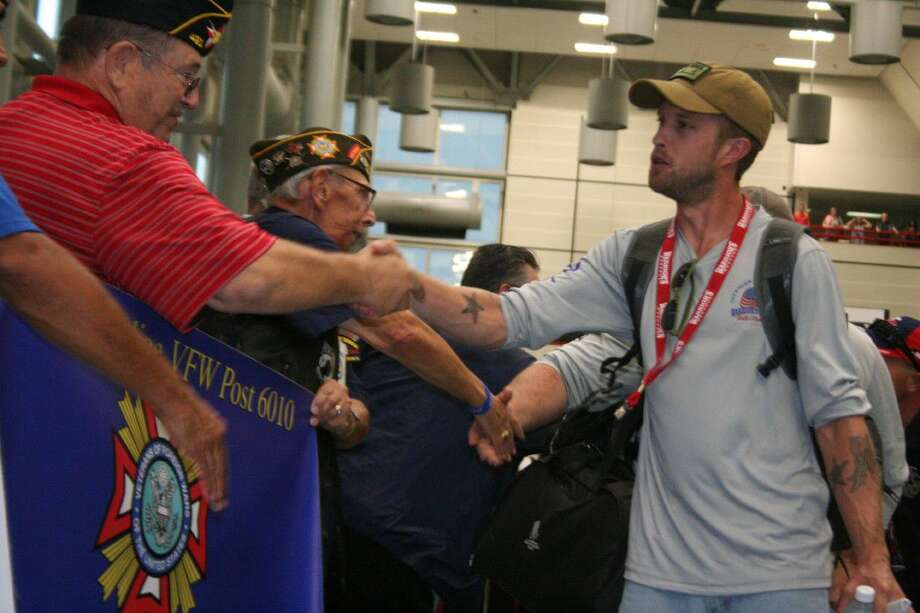Community members and members of a local VFW had the chance to welcome Wounded Warriors at IAH Thursday, May 19, 2016, as they head out for Wounded Warriors weekend which includes deep-sea fishing trip in Port O'Connor