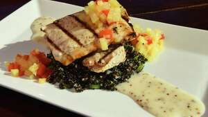 Grilled mahi-mahi at the Savoy Taproom at 301 Lark Street on Thursday Sept. 29, 2016 in Albany , N.Y. (Michael P. Farrell/Times Union)