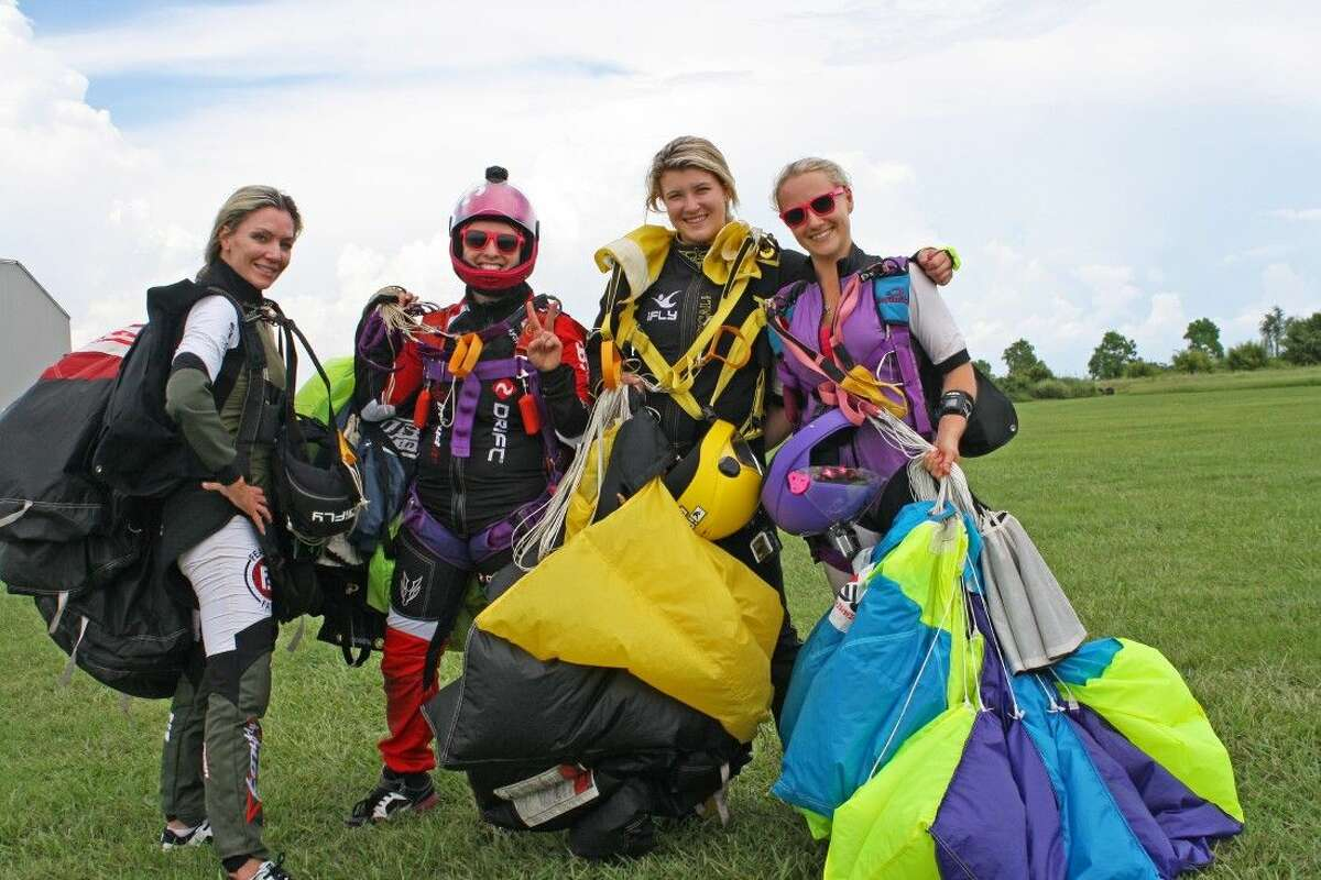 The four women who set the record-Cara Considine and Charity Kelly of the Dallas area with Tammie Frank and Alexandra Neale of Houston-were part of a group of 12 women working together to achieve the world record.