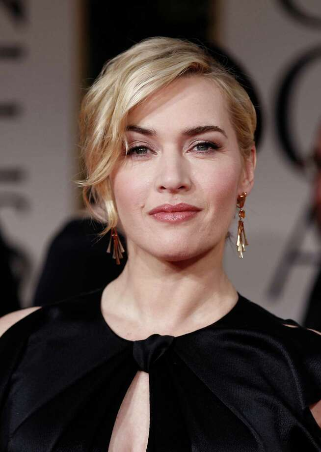 FILE- In this Jan. 15, 2012, file photo showing Kate Winslet arriving on the red carpet before the 69th Annual Golden Globe Awards in Los Angeles, USA.  Kate Winslet has been honored by Queen Elizabeth II for her titanic contribution to the arts, as she has been named a Commander of the Order of the British Empire, or CBE, in the queen's Birthday Honors List, Saturday, June 16, 2012. (AP Photo/Matt Sayles, file) Photo: Matt Sayles / AP