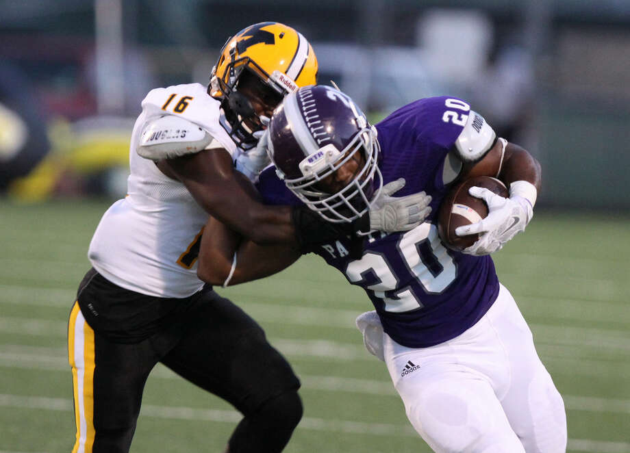 Ridge Point's KeShawn Ledet runs against Marshall's Donovan Carter during game at Hall Stadium in Missouri City on Thursday, September 25, 2014. To view or purchase this photo and others like it, go to HCNPics.com. Photo: Staff Photo By Alan Warren