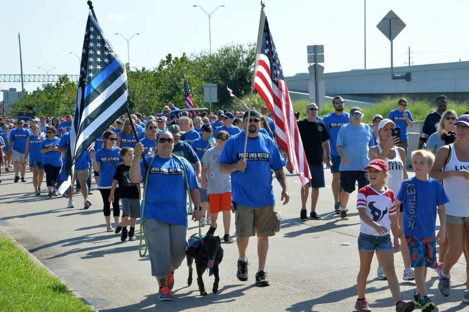 Saturday's Police Lives Matter March in northwest Houston was very orderly thanks to the efforts of dozens of law enforcement officers who volunteered their time for traffic and crowd control work.