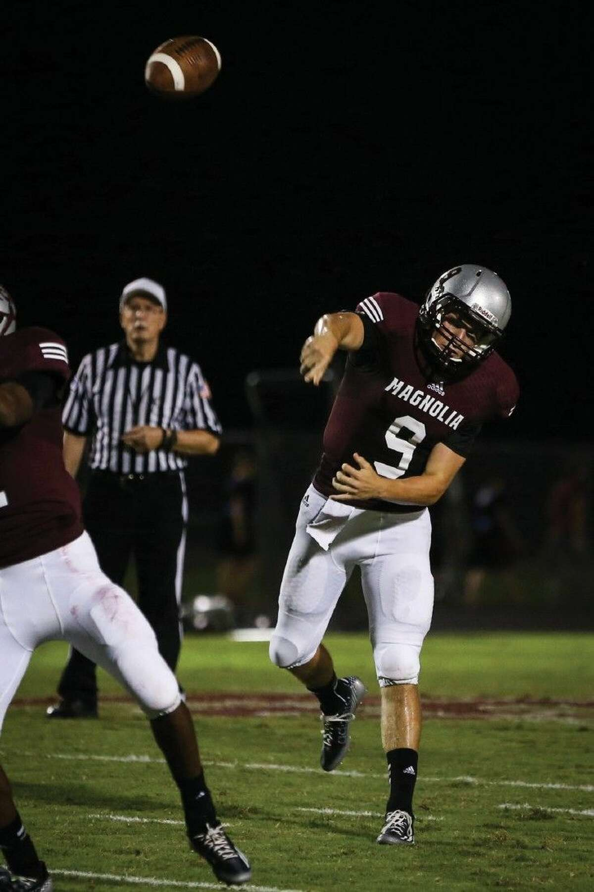 Photo by Michael Minasi/Magnolia's Jacob Frazier (9) throws a pass during the high school football game against Willis on Friday, Sept. 12, 2014, at Magnolia High School. To view or purchase this photo and others like it, go to HCNPics.com.