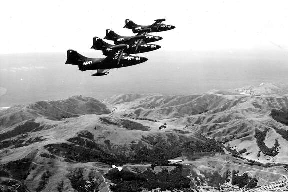 Members of the U.S. Navy Blue Angels demonstration team fly over San Francisco in 1950. Seen here over Marin County.