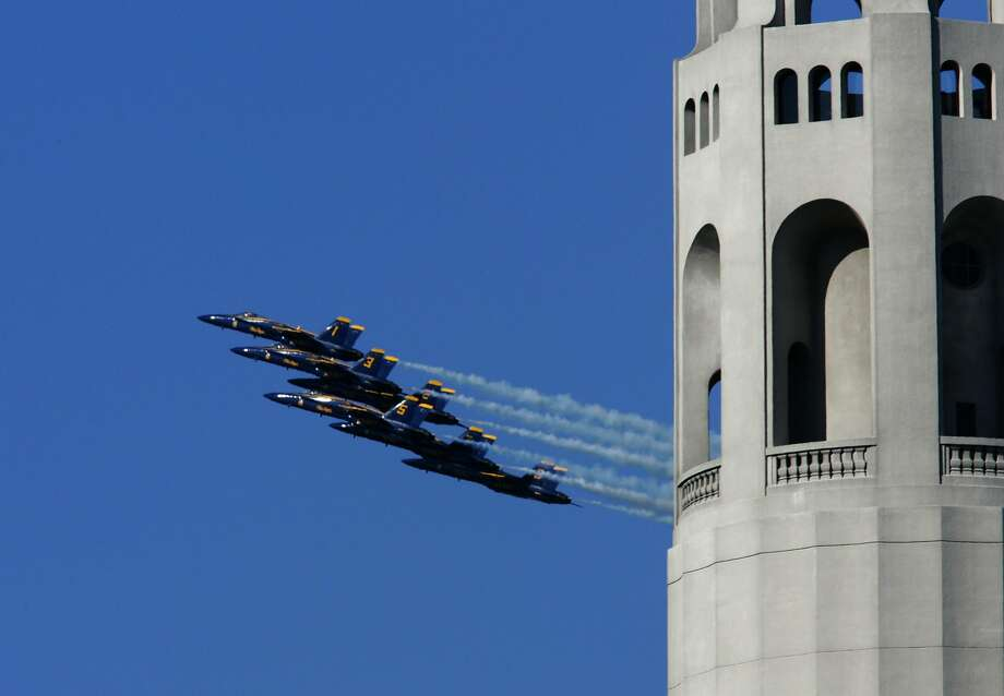 The Blue Angels fly around the Bay Area near landmarks including Coit Tower on a practice run before previous shows for Fleet Week. Photo: Deanne Fitzmaurice, SFC