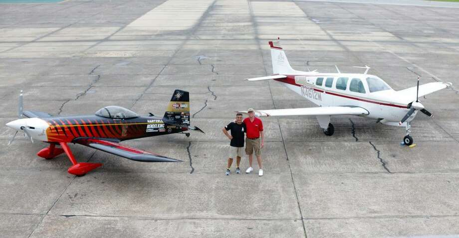 Bruce Bohannon and Alex Tapia posing with the World Record Breaking Flyin' Tiger and the ARS A36 Bonanza.