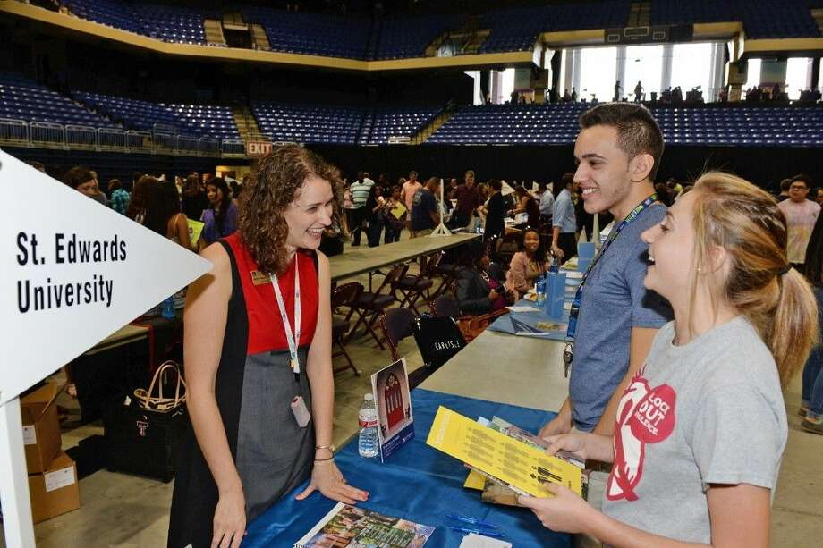 Cypress Lakes High School juniors William Ayala and McKenzie Thompson learn more about St. Edward's University from Leora Rockowitz, assistant director of admission, during the 20th annual College Night. Photo: Submitted Photo