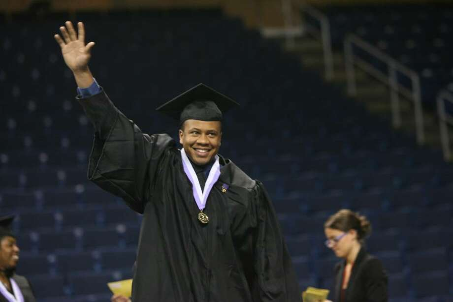 Isaiah Campbell, of Bridgeport, receives his Associate of Science at the University of Bridgepor's One Hundredth Commencement ceremony on Saturday, May 8 2010 at the Arena at Harbor Yard. Photo: B.K. Angeletti / Connecticut Post