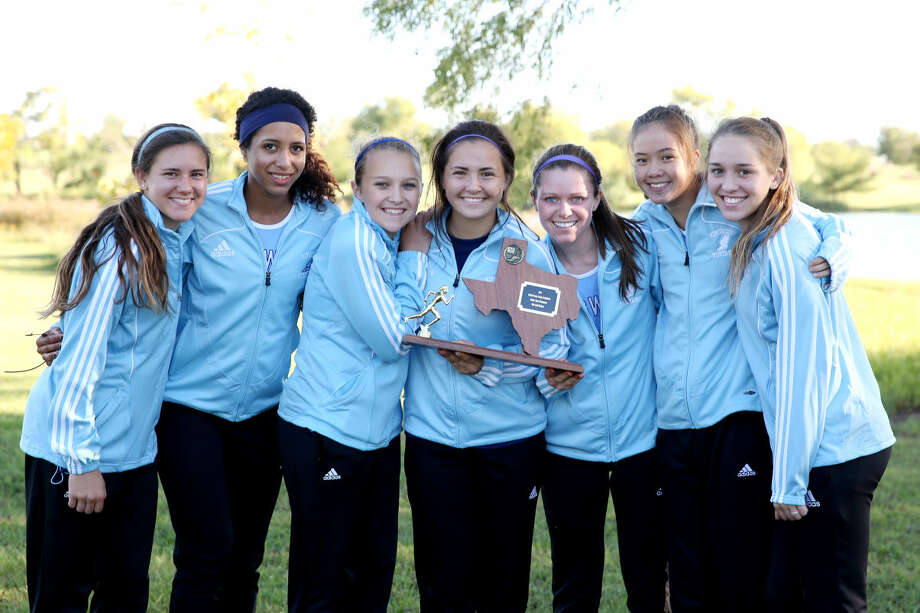 The Kingwood girls cross country team took home the team title at the McNeil Invitational on Saturday. From left, Abby Guidry, Jasmine Amo, Erin Gallagher, Jennifer Poston, Erin Greenwood, Amy Berg, and Olivia Thompson.