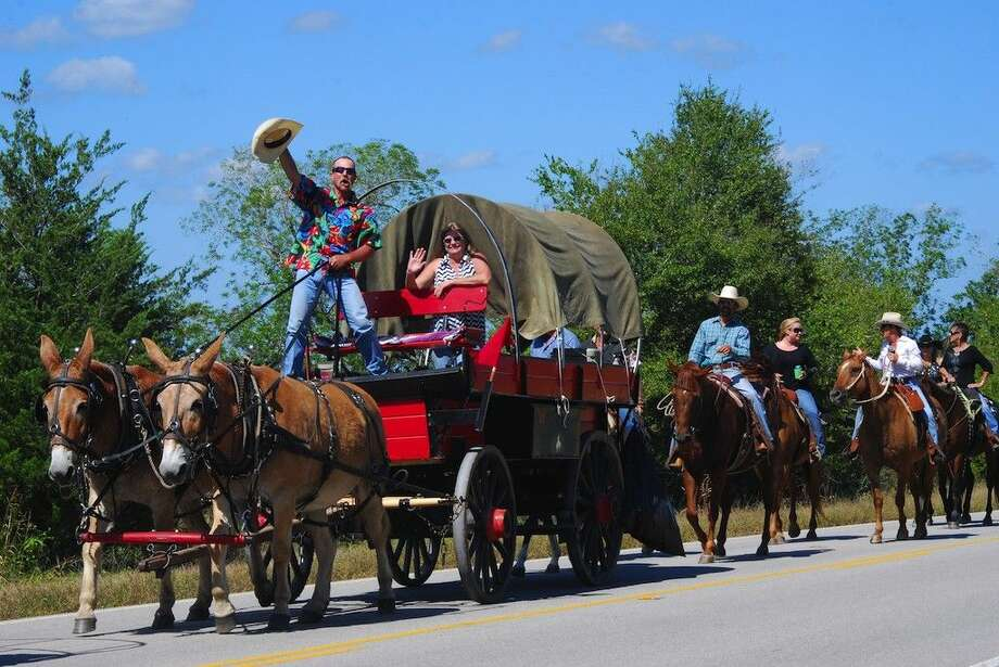 TVE trail riders make their way south on FM 1011 Sunday, Oct. 5, headed to the fairgrounds. Photo: Casey Stinnett