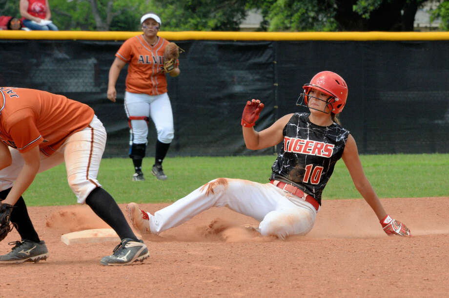 Katy's Nicole Valdez slides safely into second base against Alvin during Game 2 of their Region 3 Semifinal, May 21 at Katy High School. The defending state champion Lady Tigers meet Pearland for the regional championship. View this and additional photos at HCNPics.com. Photo: Craig Moseley