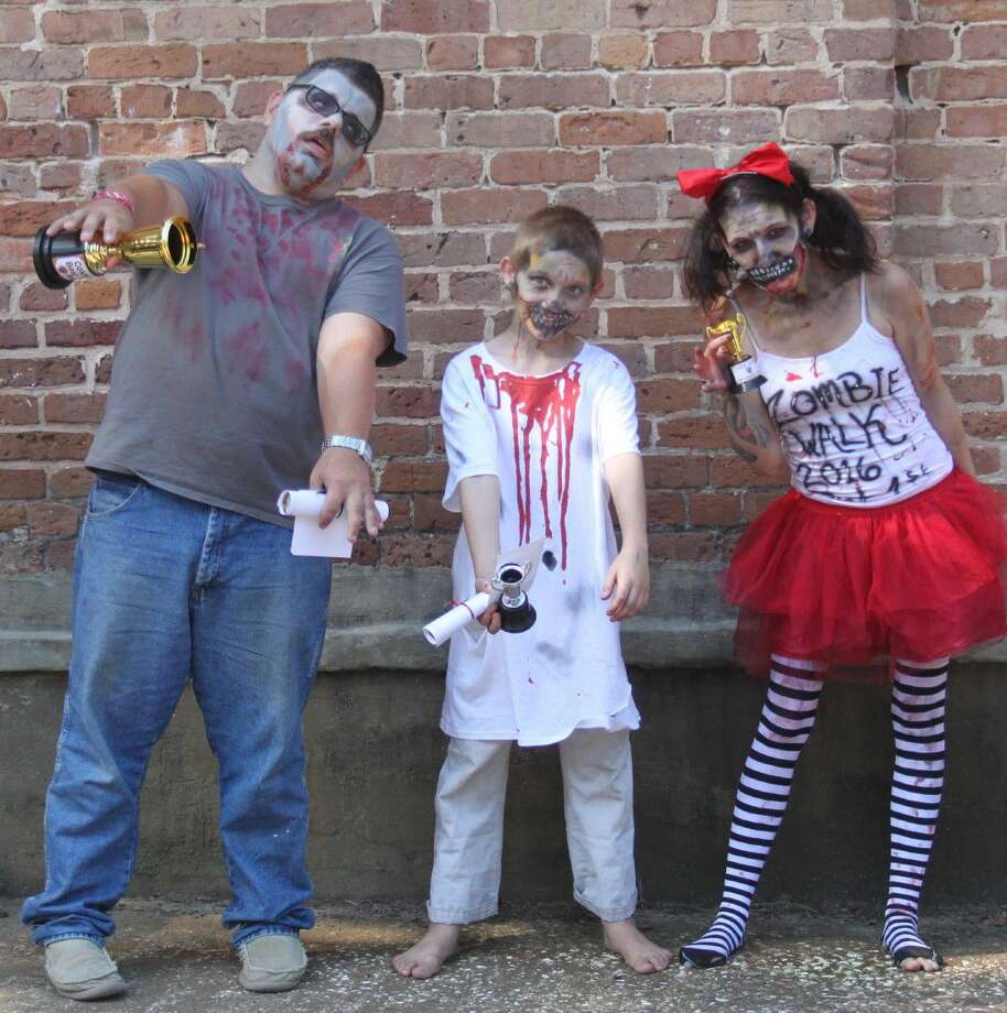Zombies slowly make their way through the city of Coldspring during the San Jacinto County Historical Commission's first annual Zombie Walk. Photo: Jacob McAdams/Eastex Advocate