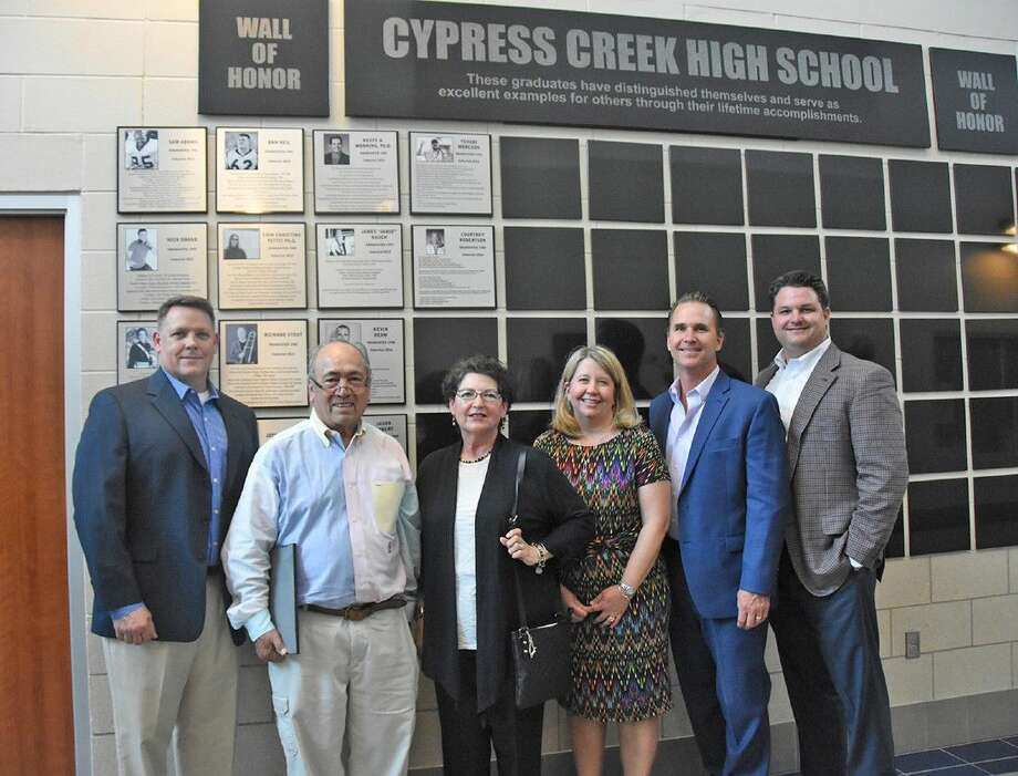 The Cypress Creek High School Wall of Honor Class of 2016 stands in front of the Wall at the school after being inducted on May 18. Pictured, from left, are LtCol. Jason Colbert; Gerry and Leigh Mercado, parents of inductee Yehudi Mercado; Dr. Courtney Robertson; Dr. Kevin Beam; and TJ Farnsworth.