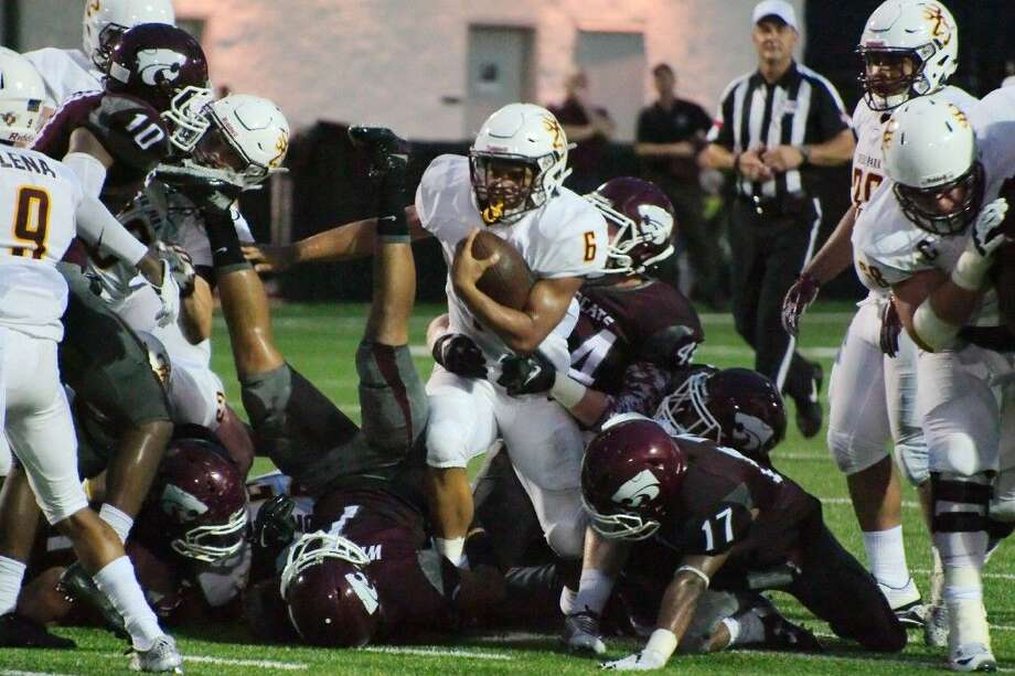 Sammy Linton leaves a wall of maroon behind him during one of his many runs Thursday night. Photo: Kirk Sides