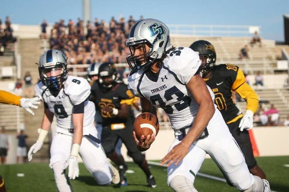 College Park's Dominic Garcia (33) returns a kick off during the high school football game against Aldine Eisenhower on Saturday at Thorne Stadium. To view more photos from the game, go to HCNPics.com. Photo: Michael Minasi