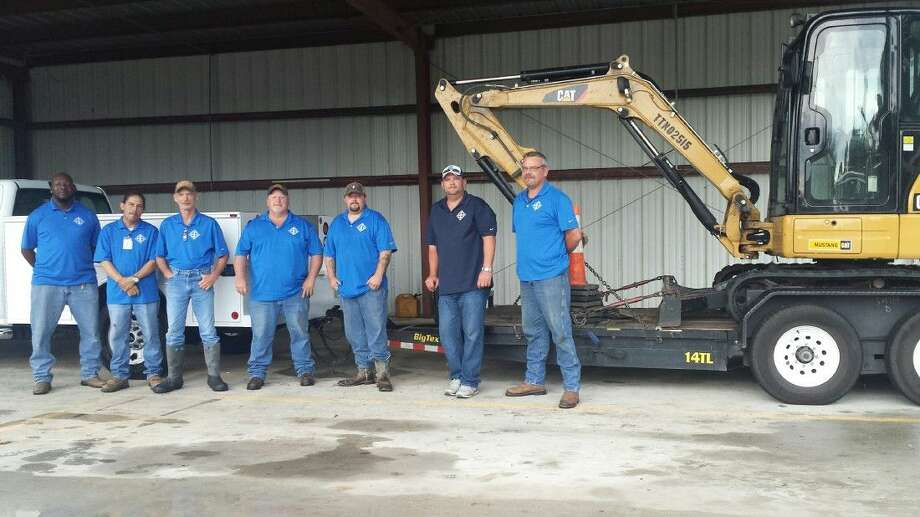 Porter SUD employees with equipment they use on a daily basis when handling services in the district.