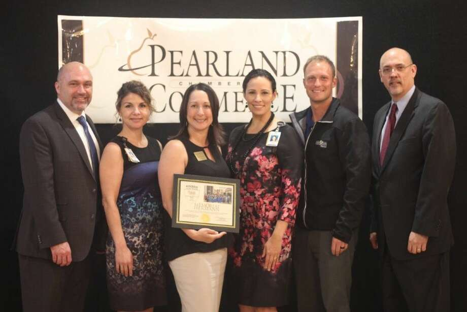 Representing Memorial Hermann and accepting the award are from L-R Shane Crisp, Shannon Kimich, Donna Coneley, Corrina Abrego and Gerrit Von Wenckstern and John Lyle, VII - Kelsey Seybold and Chair of the Board of The Pearland Chamber of Commerce.
