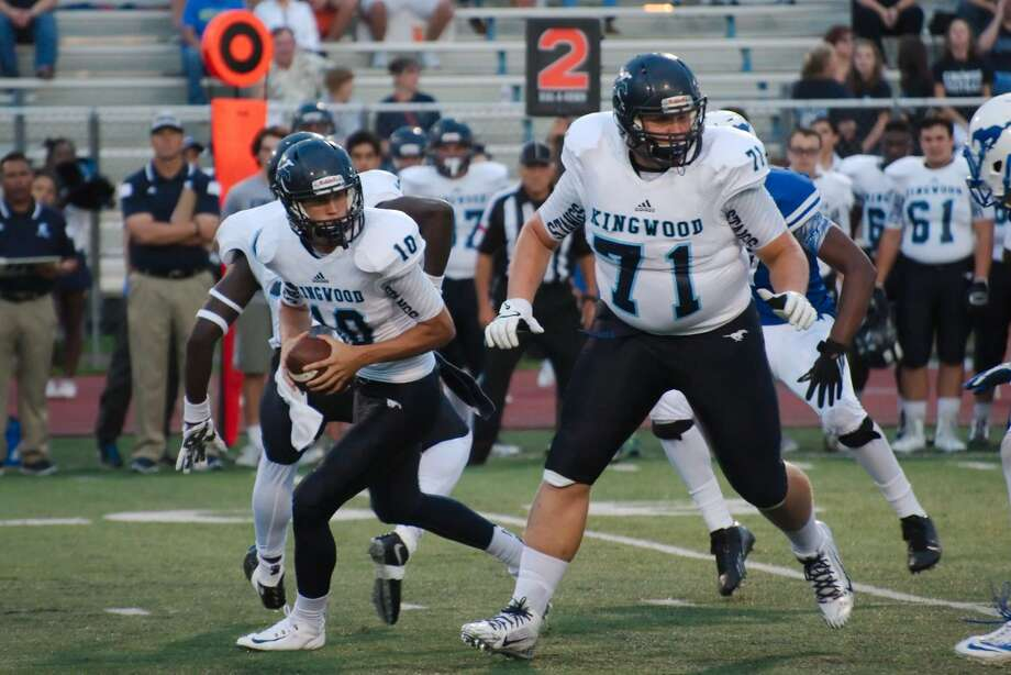 Kingwood's Dawson Trudell (10) looks for protection behind Luke Vaughters (71) against Friendswood Friday, Sep. 11. Photo: Kirk Sides