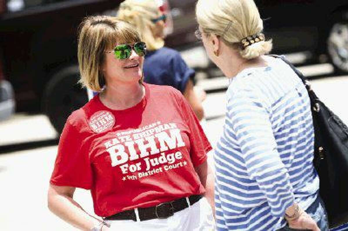 Kate Shipman Bihm, candidate for 9th District Court Judge, speaks with supporters during early voting on Friday, May 20 at the South County Community Center.