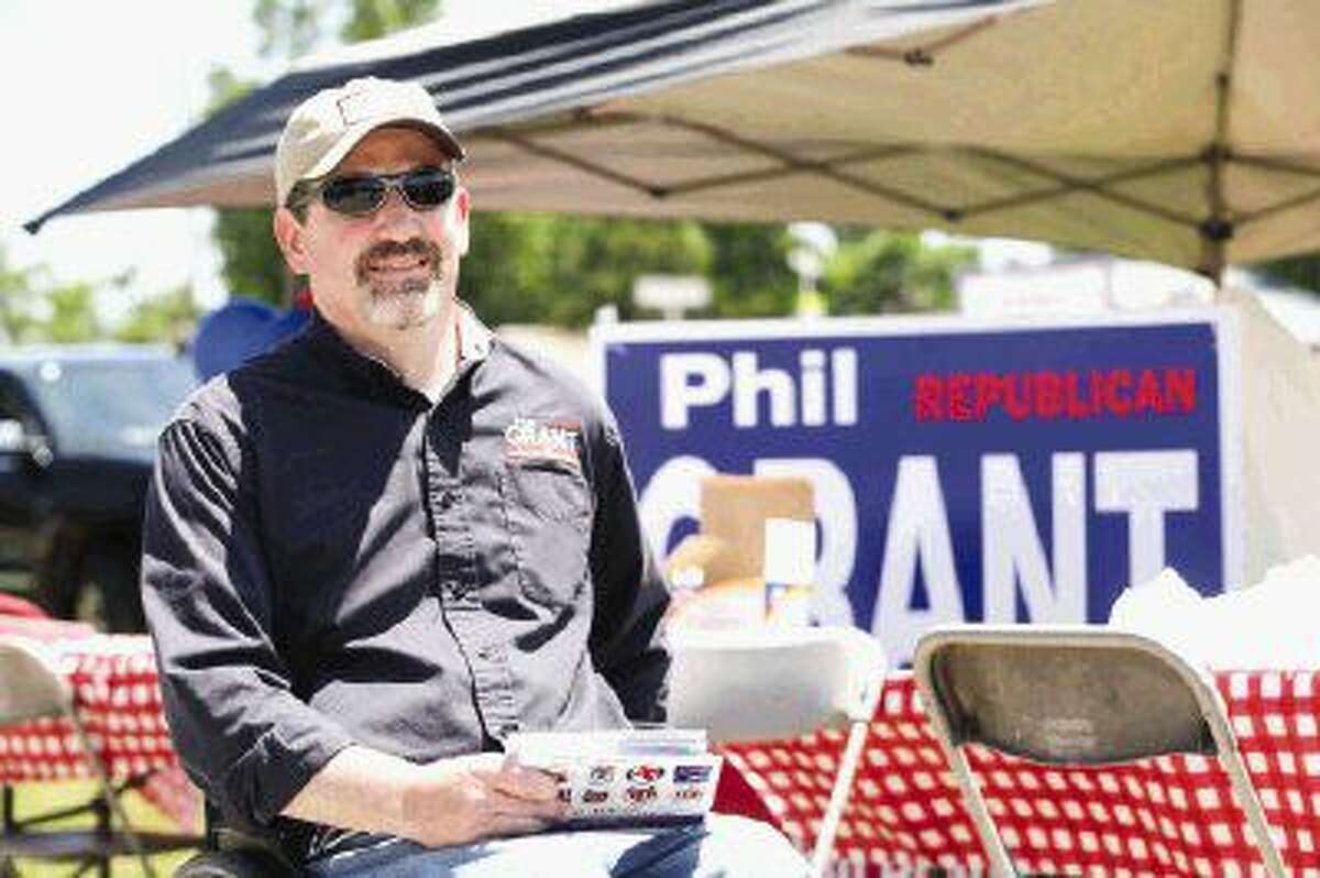 Phil Grant, candidate for 9th District Court Judge, hands out flyers during a meet and greet hosted by Constable David Hill on Friday, May 20 at the Magnolia polling location.