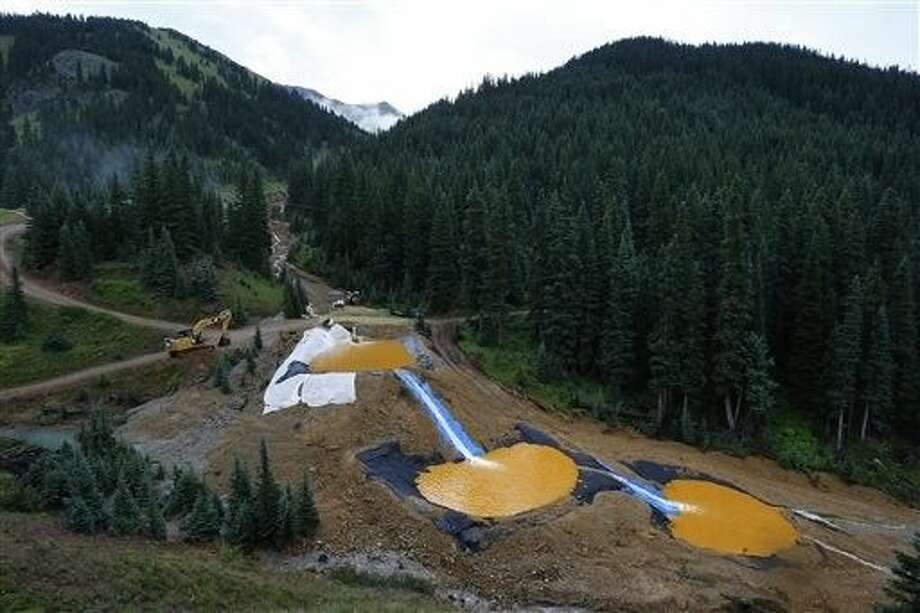 Federal officials say they have suspended cleanup work and investigations covering 10 mining sites in four states to guard against a repeat of last month's massive wastewater spill from an inactive Colorado gold mine. Photo: Brennan Linsley