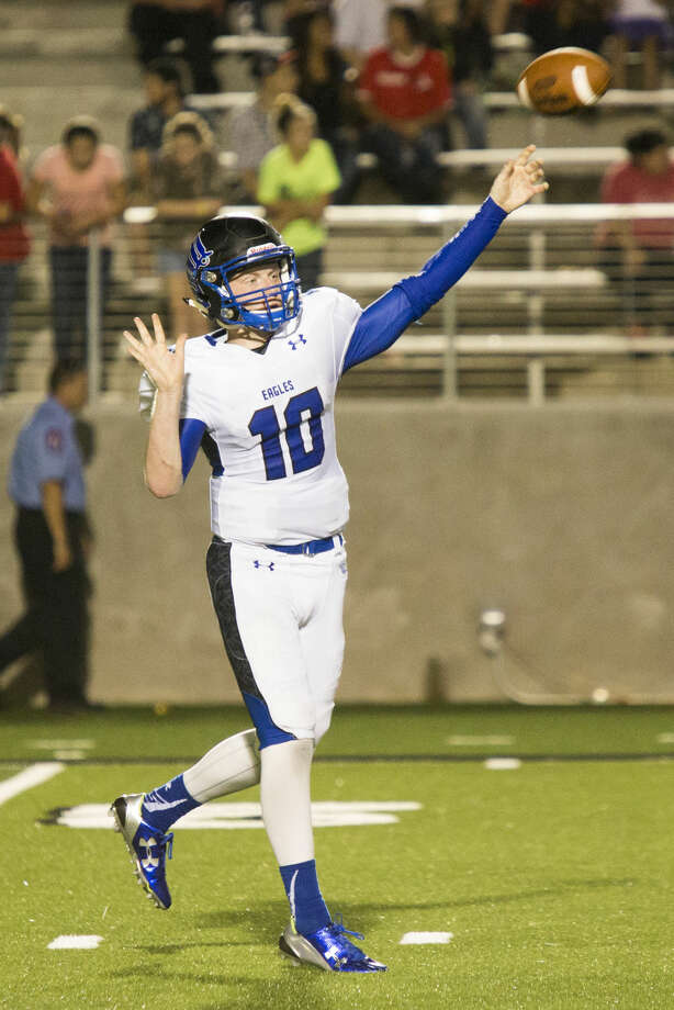 Eagles quarterback Timmy Ware (10) passes during New Caney's Battle Line on 59 matchup against Porter on Sep. 11, 2014, at Texan Drive Stadium. Photo: Andrew Buckley