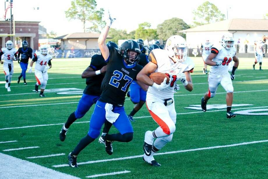Clear Springs' Blake Tessitore (27) runs down La Porte's Hunter Hebert Saturday, but was unable to strip the ball in making the tackle. Photo: KIRK SIDES