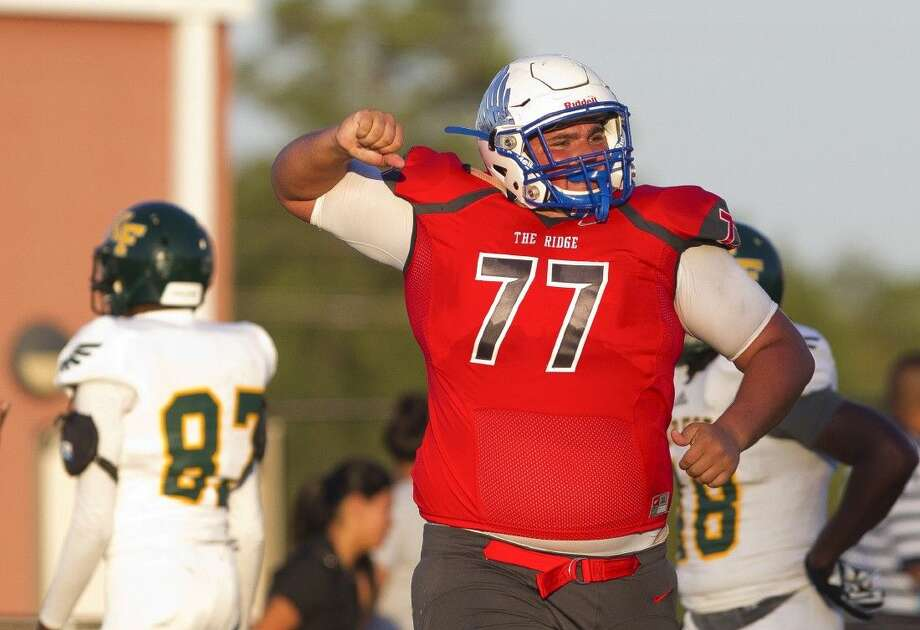 Oak Ridge offensive linemen Jeremy Parker celebrates after recovering a fumble by running back Josh Williams in the endzone for a touchdown in the second quarter of a high school football game Saturday. To view or purchase this photo and others like it, visit HCNpics.com.