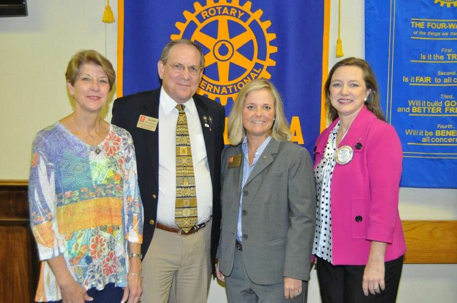 Pictured from left are Rotarian Jackie Barmore, Past Governor Bob Gebhard, Governor Massey and Club President Niki Whiteside. Photo: Bill Welch