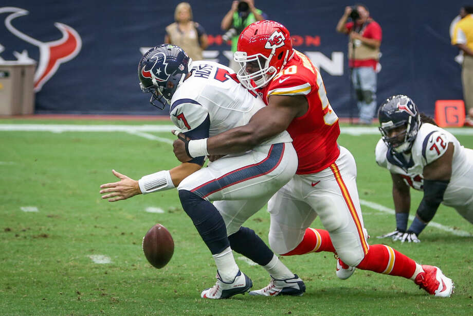 Houston Texans quarterback Brian Hoyer is sacked by Kansas City Chiefs linebacker Justin Houston, forcing a fumble during the NFL football game on Sunday at NRG Stadium. Photo: Michael Minasi