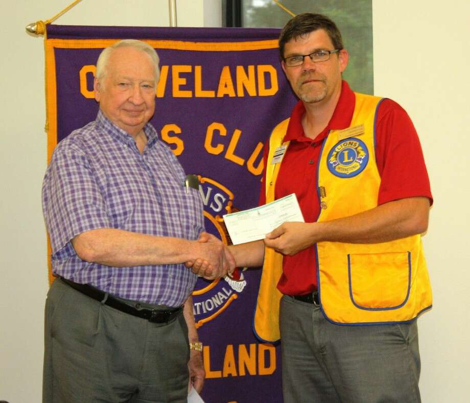 Alfred Anderson presented Cleveland Lions Club President Thomas Higgins with a check for $10,000 on Tuesday, Sept. 8, on behalf on Anderson Ford. Photo: Stephanie Buckner