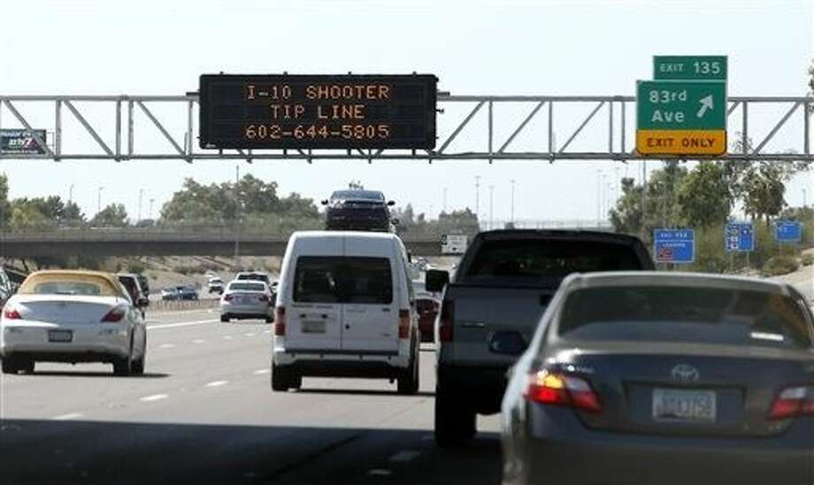 Authorities have a person of interest in custody in a string of freeway shootings over the past two weeks and the man's white Chevrolet Tahoe, raising hopes of a resolution to the rash of freeway shootings rattling the metro area. Photo: Ross D. Franklin