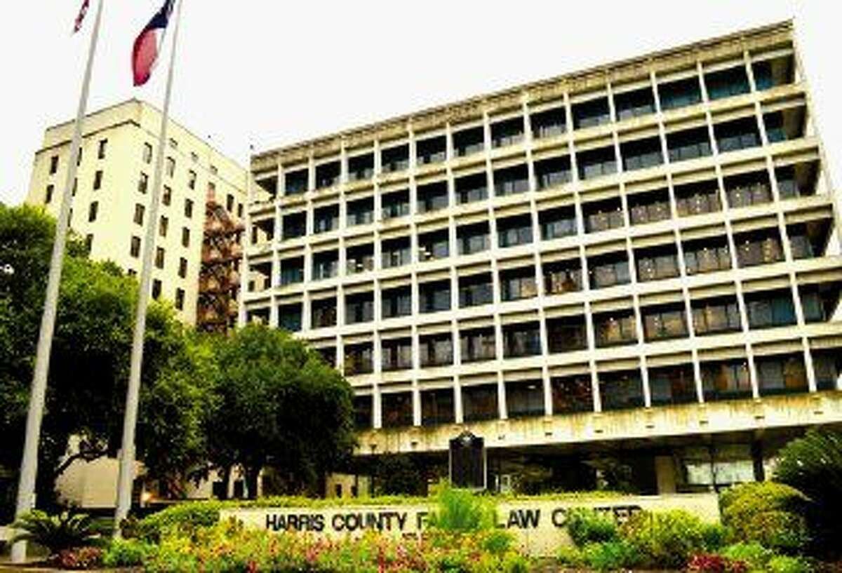 Harris County is considering renovating the old district attorney's building, left, and the Family Law Center.
