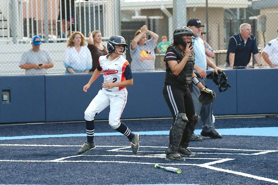 Seven Lakes' Alexis Mirabal crosses the plate during the Lady Spartans' game two victory against Pearland in the Region III-6A semifinals May 20 at Sweeny High School. Visit HCNPics.com for more photos. Photo: Kirk Sides