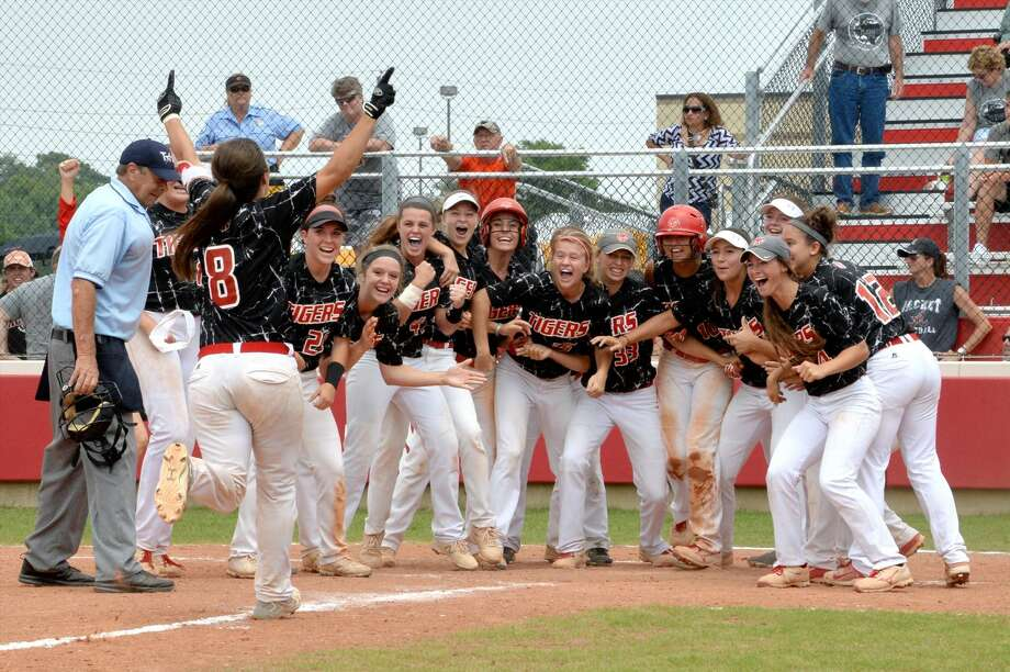 The Katy softball team waits at the plate for Corey Burrough (8) after her game-winning, two-run home run in game two of the Region III-6A semifinals May 21 at Katy High School. Visit HCNPics.com for more photos. Photo: Craig Moseley