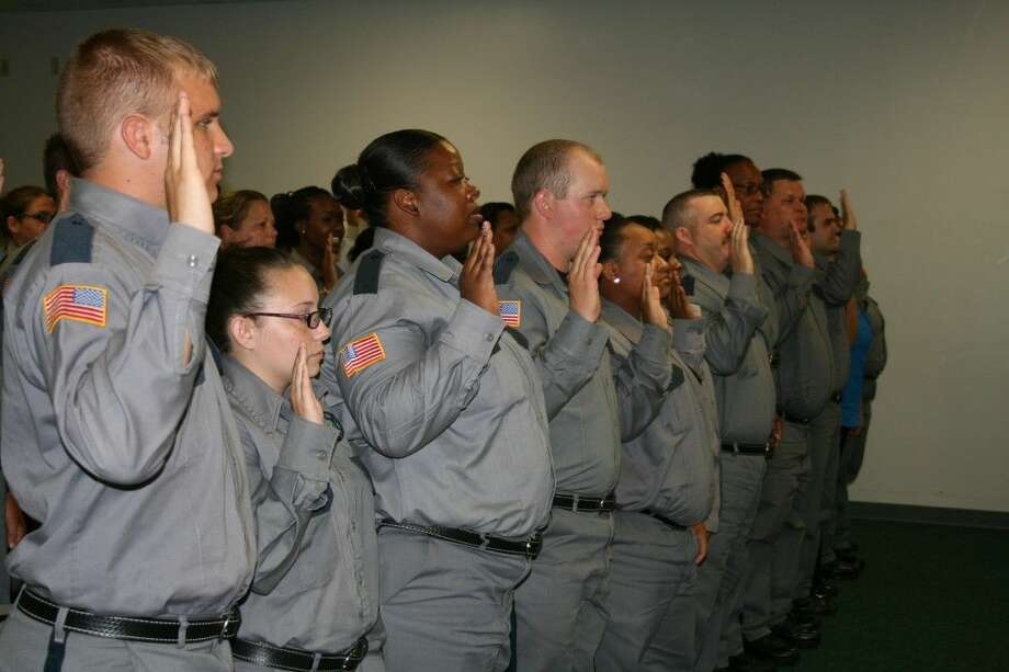 More than three dozen new correctional officers take their oaths of office at a training academy graduation ceremony on Friday, Sept. 11, at Plane State Jail in Dayton. Photo: Vanesa Brashier
