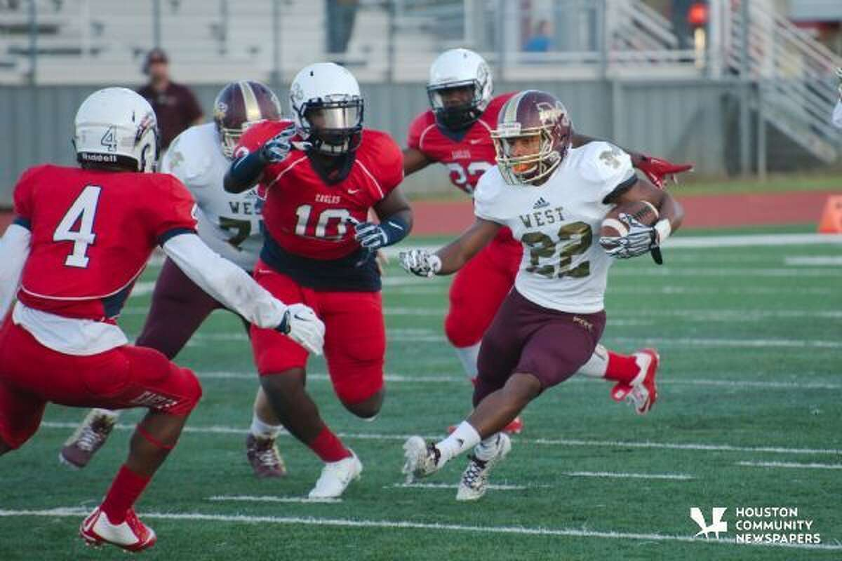 Magnolia West's Adrian Thomas (22)is pursued by Dawson's Bryce Victorian (4) and Dawson's Patrick Howell (10) in earlier action from Sep. 4.
