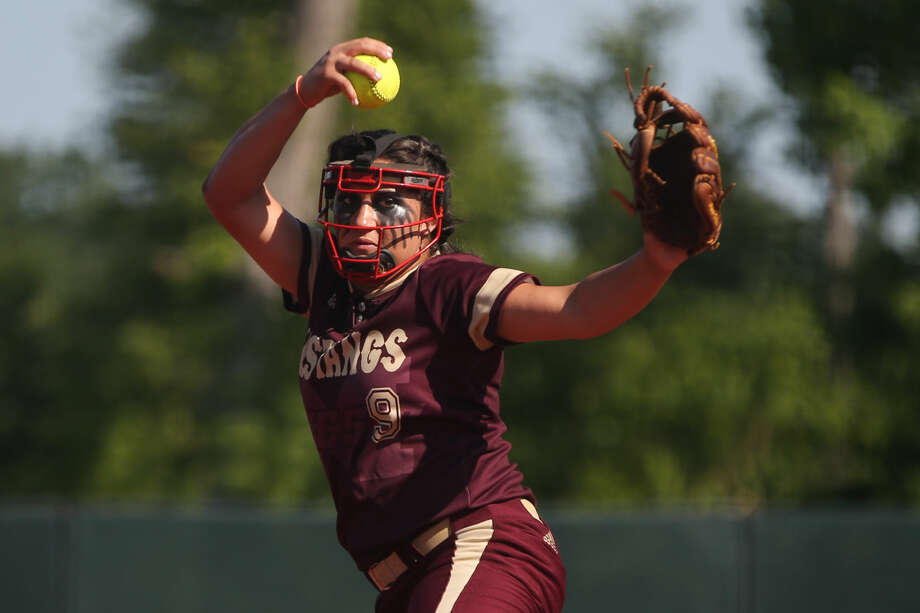 Magnolia West's Ariana Adams (9) throws a pitch during high school softball playoff game one against Barbers Hill on Friday, May 20, 2016, at the Scrap Yard sports complex. To view more photos from the game, go to HCNPics.com.