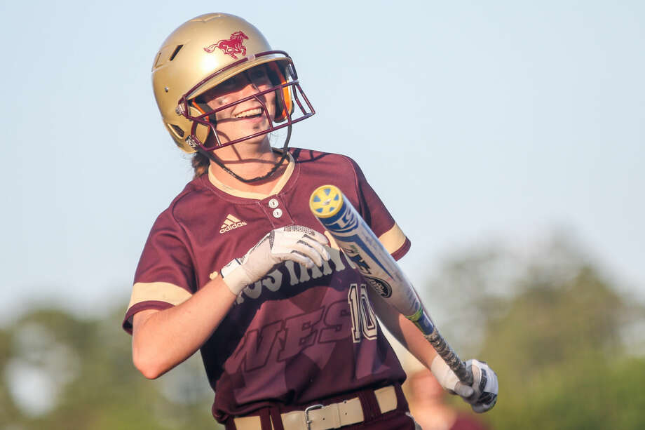 Magnolia West's Emma McBride (10) laughs at teammates in the dugout while she walks up to bat during high school softball playoff game one against Barbers Hill on Friday, May 20, 2016, at Scrap Yard Sports. To view more photos from the game, go to HCNPics.com.