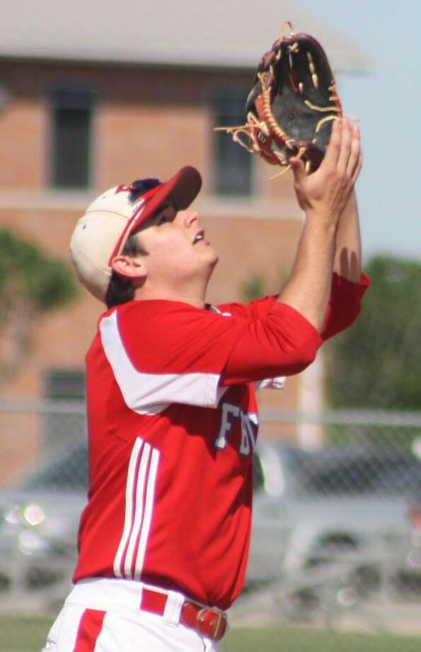 Camping under a fly ball during a playoff game, FBCA shortstop Nace Sweeney snared First Team All-District honors again for the Warriors. Photo: Robert Avery