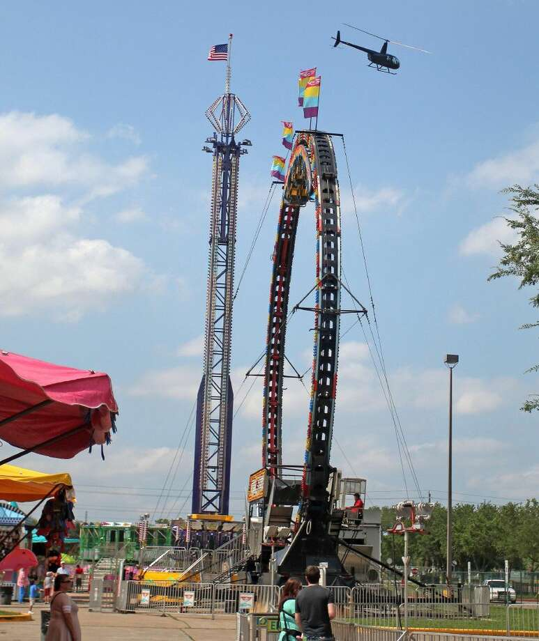 A helicopter flies by the carnival and rides are available at the festival. Photo: Kar B Hlava